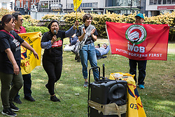 London, UK. 1 June, 2019. A cleaner working at Chanel addresses members of the United Voices of the World (UVW) grassroots trade union in Cavendish Square. Yesterday Chanel agreed to pay its cleaners the London Living Wage in advance of a protest organised by the United Voices of the World trade union. Union members later protested inside the DoubleTree Hilton Hotel in solidarity with Dalia Quinonez Guerrero, a former cleaner from whom wages had been withheld.
