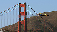 San Francisco. CA. #5 of the Blue Angels flies between the towers of the Golden Gate Bridge over the San Francisco bay.<br /> <br /> Photograph by Alan Brian Nilsen ©Alan Brian Nilsen/ABN photography