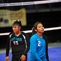 111612  Adron Gardner<br /> <br /> Navajo Prep Eagles Keona Leano (13) and  Lynnshellrea Begay (2) leave the court after the Santa Rosa Lions beat the Egales in the state volleyball quarterfinals at the Santa Ana Star Center in Rio Rancho Friday.