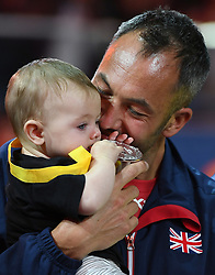 Michael Westwell from team Great Britain collects his Invictus Games seated volleyball silver medal with his 5 month old daughter Holly at the Mattamy Athletic Centre, Toronto, Ontario, Canada, on the 27th September 2017. 27 Sep 2017 Pictured: Michael Westwell from team Great Britain collects his Invictus Games seated volleyball silver medal with his 5 month old daughter Holly at the Mattamy Athletic Centre, Toronto, Ontario, Canada, on the 27th September 2017. Picture by James Whatling. Photo credit: James Whatling / MEGA TheMegaAgency.com +1 888 505 6342