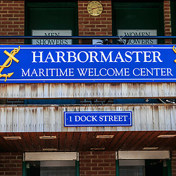 Annapolis, MD / USA - July 9, 2017: The Harbormaster sign posted on the Maritime Welcome Center near the docks in Maryland's capital city.