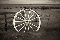 Bienvenidos (Welcome) Wagon Wheel Along a Wood and Barbed Wire Fence at an Estancia in Patagonia. Image taken with a Nikon D3s and 50 mm f/1.4G lens (ISO 200, 50 mm, f/4, 1/2000 sec).