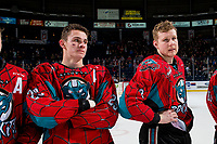 KELOWNA, CANADA - MARCH 16:  Nolan Foote #29 and Dalton Gally #3 of the Kelowna Rockets line up on the blue line for the shirt off the back presentation after the OT win against the Vancouver Giants on March 16, 2019 at Prospera Place in Kelowna, British Columbia, Canada.  (Photo by Marissa Baecker/Shoot the Breeze)