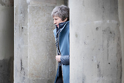 © Licensed to London News Pictures. 04/03/2019. Salisbury, UK. Prime Minister Theresa May emerges from The Guildhall during a visit to Salisbury on the first anniversary of the poisoning of former Russian spy Sergei Skripal and his daughter Yulia in March 2018. They both survived the nerve agent attack but a resident of nearby Amesbury, Dawn Sturgess, died in June 2018 after coming in contact with the poison. Two Russians have been named in connection with the attack. Photo credit: Peter Macdiarmid/LNP