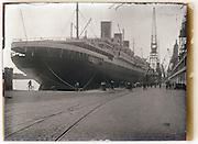 passenger ocean liner ship moored in harbor 1930s