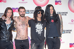 Myles Kennedy, Simon Neil and Slash with the rest of the band, backstage at the winners room MTV EMA, Glasgow.