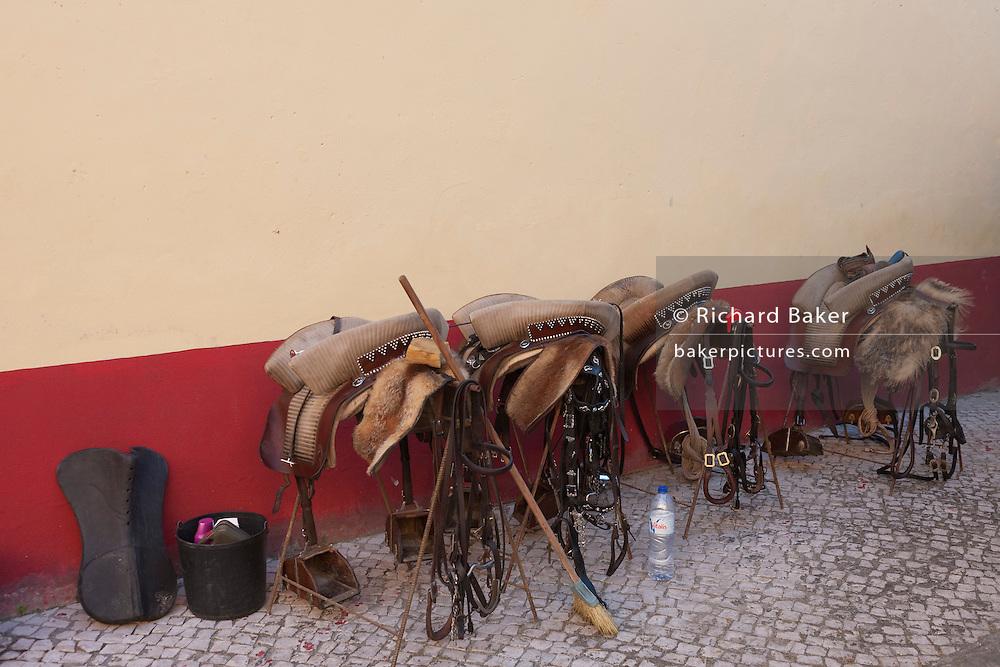 Saddles belonging to the horses of the Corrida de touros (bullfight) at Caldas da Rainha, Portugal. Unlike Spanish bullfights, in the Portuguese version, they do not kill the bull.