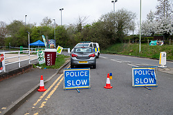 © Licensed to London News Pictures. 01/04/2021. Reading, UK. A road closure on Chalfont Way, Lower Earley, Reading following a serious incident of assault outside a BP petrol station which occurred at approximately 7:40pm on Wednesday 31/03/2021, a 51-year-old man was taken to the Royal Berkshire Hospital in a critical condition with life-threatening injuries. Photo credit: Peter Manning/LNP