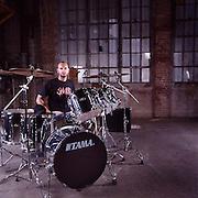 Matt Byrne of Hatebreed poses with his Tama chrome finish drum set.