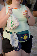 young obese girl with ice cream and food in her hands