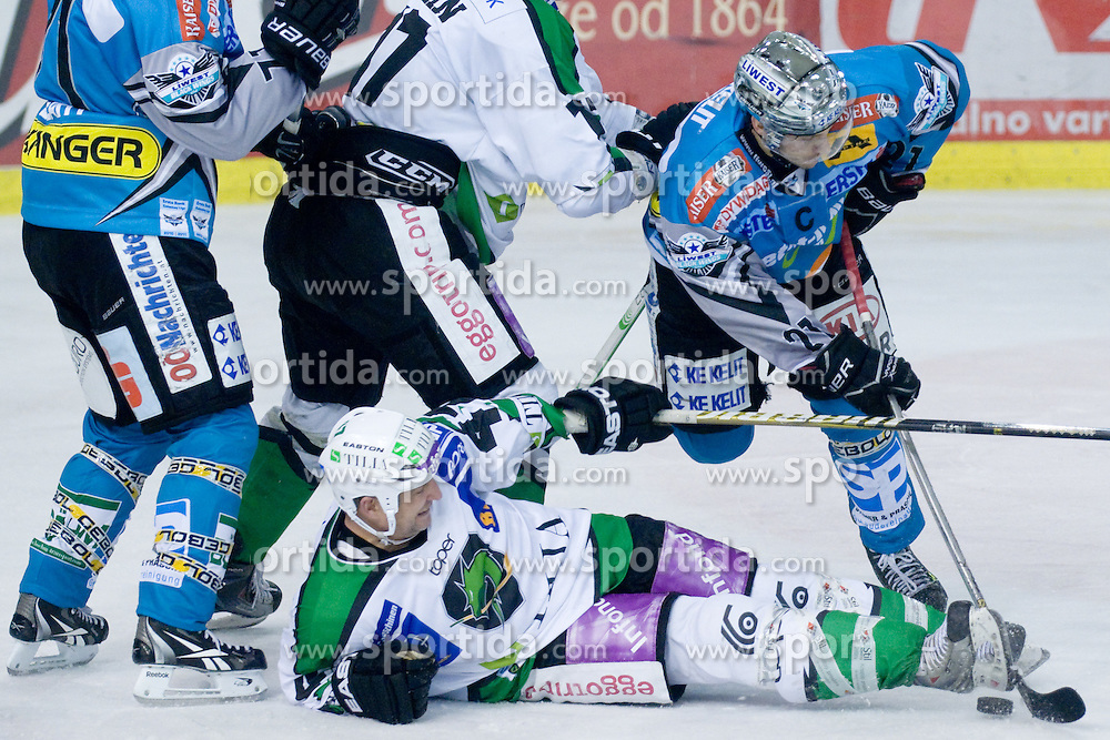 Jeff Tory (HDD Tilia Olimpija, #47) and Philipp Lukas (EHC Liwest Black Wings Linz, #21) during ice-hockey match between HDD Tilia Olimpija and EHC Liwest Black Wings Linz in 37th Round of EBEL league, on Januar 9, 2011 at Hala Tivoli, Ljubljana, Slovenia. (Photo By Matic Klansek Velej / Sportida.com)