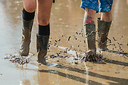 A large puddle left over from teh previous nights rain addsto the problems of moving around  albeit some see it as a leisure facility- 2016 Glastonbury Festival, Worthy Farm, Glastonbury.