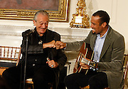 """April 9, 2013 - Harmonica great Charlie Musselwhite and Ben Harper played a song together during a Memphis music workshop in the State Dining Room at the White House on Tuesday. The workshop event: """"Soulsville, USA: The History of Memphis Soul""""  was attended by students from all over the country, including two from Stax Academy in Memphis.  It was hosted by Michelle Obama. Musselwhite grew up in Memphis and recently recorded with Ben Harper.  Harper plays an eclectic mix of blues, folk, soul, reggae and rock music. Harper, who is not from Memphis,  said during the workshop, that he was influenced by many of the artists in the room."""