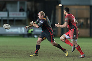 Brok Harris of the Newport Gwent Dragons passes the ball as Nasi Manu of Edinburgh closes in. Guinness Pro12 rugby match, Newport Gwent Dragons  v Edinburgh rugby at Rodney Parade in Newport, South Wales on Sunday 27th November 2016.<br /> pic by Simon Latham, Andrew Orchard sports photography.