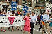 U. S. Representative Carolyn Maloney, representing the 14th district of New York, marching in the 2011 Pride Parade on New York's Fifth Avenue.