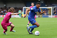 AFC Wimbledon defender Terell Thomas (6) taking on Rochdale defender Luke Matheson (41) during the EFL Sky Bet League 1 match between AFC Wimbledon and Rochdale at the Cherry Red Records Stadium, Kingston, England on 5 October 2019.
