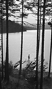 """9005-01. """"Spirit Lake from Fassett cottage"""" Spring 1915. (Mr. & Mrs. C. M. Fassett. He was a Spokane city commissioner who owned a house on Spirit Lake, and a board member of the Spirit Lake Chautauqua Association)"""