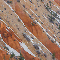Recently fallen snow contrasts beautifully with the ochre hues of Bryce Canyon National Park.