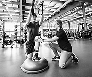 Alpine skier Broderick Thompson performs some exercises with physiotherapist Sarah Robinson at the Canadian Sport Institute Calgary high performance training centre in Calgary, Alberta on May 5, 2017.