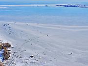 Nederland, Noord-Holland, Gemeente Waterland, 13-02-2021; door de strenge winter en de stevige vorst is zelfs het water van de Gouwzee bevroren. IJszeilers en schaatsers maken tochten tussen Monnickendam en Marken (in de achtergrond).<br /> Due to the severe winter and heavy frost, even the water of the Gouw sea has been frozen. Ice sailors and skaters make trips between Monnickendam and Marken.<br /> <br /> luchtfoto (toeslag op standaard tarieven);<br /> aerial photo (additional fee required)<br /> copyright © 2021 foto/photo Siebe Swart