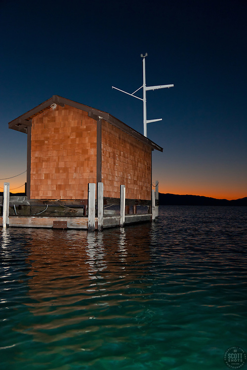 """""""Tahoe City Pier at Sunrise 1"""" - This small building on the end of a pier was photographed at sunrise near Commons Beach, Lake Tahoe. Photographed from a kayak."""