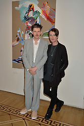 """Left to right, MATTHEW STONE and GARETH PUGH at a private view of work by Matthew Stone """"Healing The Wounds' held at Somerset House, The Strand, London on 4th July 2016."""