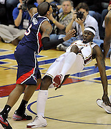 Ben Wallace takes a charge against Josh Smith of Atlanta last night.