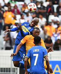Cape Town-180915-  Cape Town City  defender Thami Mkhize wins an aerial ball when challenged  challenged by Kaizer Chiefs Bernard Parker  in the ABSA Premiership clash at the Cape Town Stadium.City are trying to keep winning their home games and their position on the log.Photographs:Phando Jikelo/African News Agency/ANA