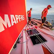 Leg 6 to Auckland, day 13 on board MAPFRE, Xabi Fernandez, Blair Tuke and Sophie Ciszek moving sails. 19 February, 2018.