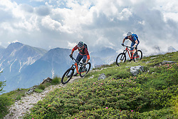 Mountain bikers riding on uphill, Trentino-Alto Adige, Italy