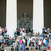 Tourists take refuge on a hot afternoon on the shaded steps of the Lincoln Memorial in Washington DC.