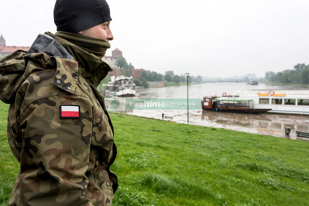 May 24, 2019 - Krakow, Poland - Polish army guard safety and security of flooded boulevard in Krakow, a popular touristic city of Poland on May 24, 2019.  After many days of heavy rain Vistula waters, the main river in Poland rise to dangerous levels. The climax of the flood went on Friday May 24, the water level risen more than 5 meters. (Credit Image: © Dominika Zarzycka/NurPhoto via ZUMA Press)