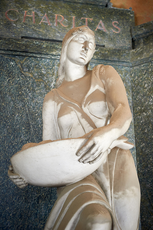 Picture of the Art Deco stone sculpture women of the Masnata tomb sculpted by E de Albertis 1935. Section A, no 22, The monumental tombs of the Staglieno Monumental Cemetery, Genoa, Italy .<br /> <br /> Visit our ITALY PHOTO COLLECTION for more   photos of Italy to download or buy as prints https://funkystock.photoshelter.com/gallery-collection/2b-Pictures-Images-of-Italy-Photos-of-Italian-Historic-Landmark-Sites/C0000qxA2zGFjd_k<br /> If you prefer to buy from our ALAMY PHOTO LIBRARY  Collection visit : https://www.alamy.com/portfolio/paul-williams-funkystock/camposanto-di-staglieno-cemetery-genoa.html