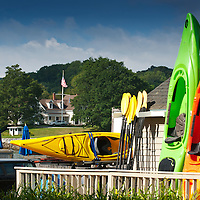 Kayak rental and sales outlet on Main Street in Damariscotta, Maine, setting up for a new buisness day.