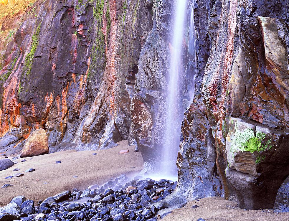 small waterfall down the rock cliff at Boiler Bay, Oregon Coast