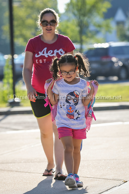 (9/1/15, MILFORD, MA) Nicole Fialho, 6, walks to school with her mom Maria during the first day of school at Brookside Elementary School in Milford on Tuesday. Daily News and Wicked Local Photo/Dan Holmes