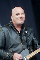 Baz Warne of The Strangers on the main stage.<br /> Saturday, T in the Park 2014.<br /> © Michael Schofield.