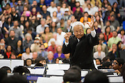 Glen Ishiwata, retired Milpitas Unified School District Assistant Superintendent of Education Services, conducts during the Milpitas Unified School District's Tenth Annual Music Festival at Milpitas High School in Milpitas, California, on April 4, 2013. (Stan Olszewski/SOSKIphoto)