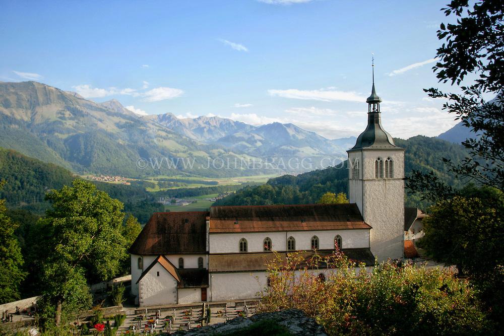The 13th Century Church of Gruyere, Cemetery, and Mount Moleson located in Gruyere, Switzerland