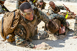U.S. Marine Corps Cpl. Anton Anderson, a student attending Corporal's Course with Headquarters Battalion, Marine Corps Base Hawaii, drags a simulated casualty during a beach ambush scenario as part of an end-of-the-course Small Unit Leadership Evaluation (SULE), Sept. 26, 2018. The mission of the SULE is to train Marines how to lead their squad during confrontation and under stress during various scenarios. (U.S. Marine Corps photo by Sgt. Zachary Orr)