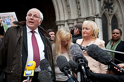 © Licensed to London News Pictures. 19/12/2012. London, UK. Trevor Hicks (L), Margaret Aspinal (C) and Jenni Hicks (R) of the Hillsborough Family Support Group speak to the media outside the Royal Courts of Justice in London after the original accidental death ruling on the 1989 Hillsborough disaster was quashed by a judge today 19/12/12). The ruling on the disaster, in which 96 football fans were crushed to death during an FA Cup semi final between Liverpool and Nottingham Forest, opens the way for a new inquest. Photo credit: Matt Cetti-Roberts/LNP
