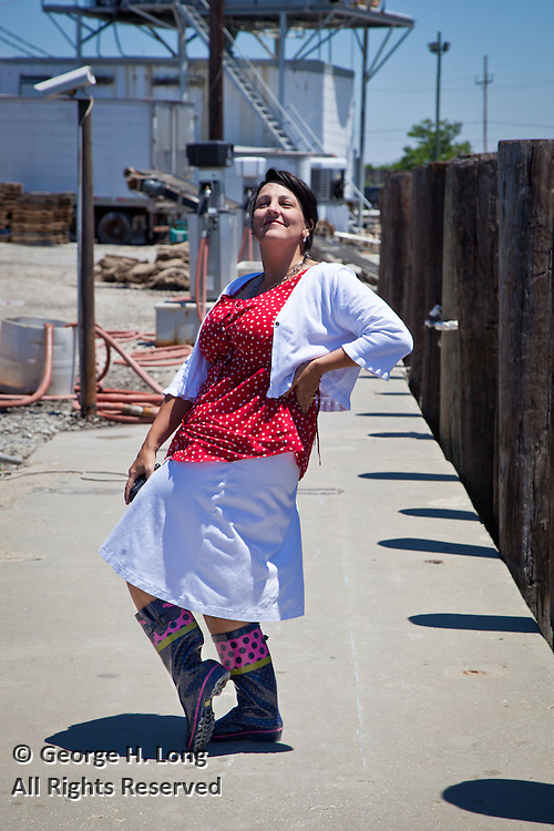 Joanna Cappiello Leopold shows off her fancy boots on a dock in Plaquemines Parish, Louisiana