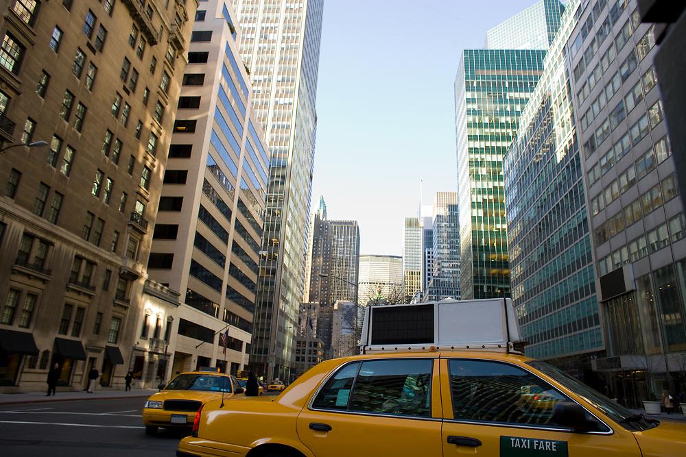 Yellow cabs on Park Avenue in midtown Manhattan, New York City, Unites States