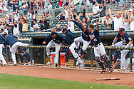 Minnesota Twins players and fans celebrate after center fielder Denard Span hit the game winning hit in the 15th inning against the Milwaukee Brewers at Target Field in Minneapolis, Minnesota on June 17, 2012.  The Twins defeated the Brewers 5 to 4.  The game was the longest in Target Field history.  © 2012 Ben Krause