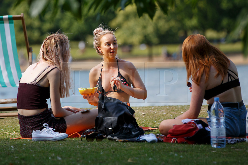 © Licensed to London News Pictures. 20/07/2016. London, UK. People enjoy hot weather in Hyde Park, London as temperatures hit 27C degrees across the capital on Wednesday, 20 July 2016. Photo credit: Tolga Akmen/LNP
