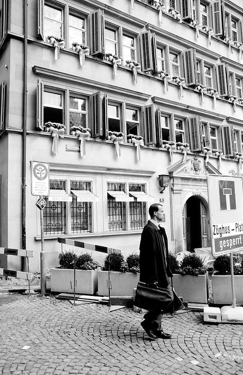 Black and white photo,businessman with a briefcase, Zurich, Switzerland