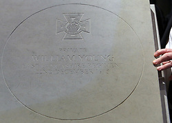 © Licenced to London News Pictures. 04/11/2013. London. UK.  <br /> General view of the winning design of the paving stone which will commemorate recipients of the Victoria Cross during the First World War at the Army and Navy Club in London, November 4th 2013. The winning design, following a national competition, will be set in stone in over 400 communities across the United Kingdom to commemorate those First World War soldiers who were awarded the Victoria Cross for valour 'in the face of the enemy'.<br /> Photo Credit: Susannah Ireland