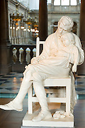 19th Century plaster sculpture 'Motherless' of father and child by George Lawson on display at Kelvingrove Art Gallery and Museum in Glasgow, Scotland