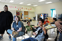 From left, Ivan Nolasco, 19, and Julianne Hunsdorfer, 22, watch Gaspar Caballero, 14, rock out on Guitar Hero 3 at the Hebbron Family Center in Salinas. Caballero is a student at Alisal High School, and Hunsdorfer is a Recreation Program Specialist with the City of Salinas Parks and Community Services Department.