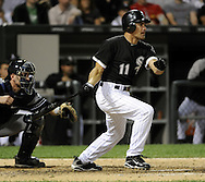 CHICAGO - AUGUST 27:  Omar Vizquel #11 of the Chicago White Sox hits an RBI single in the fourth inning against the New York Yankees on August 27, 2010 at U.S. Cellular Field in Chicago, Illinois.  The White Sox defeated the Yankees 9-4.  (Photo by Ron Vesely)